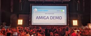 "Large audience, bigscreen reading ""Amiga Demo"" at Revision 2018 demo party"